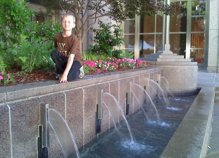 Ben on top of the Streetfront Fountain at 201 North Tryon