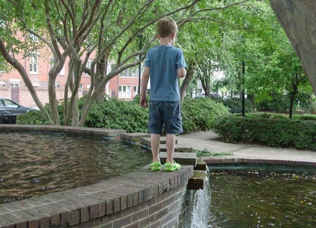 A young Ben exploring the top of the fountain at the main entrance to Fourth Ward Park