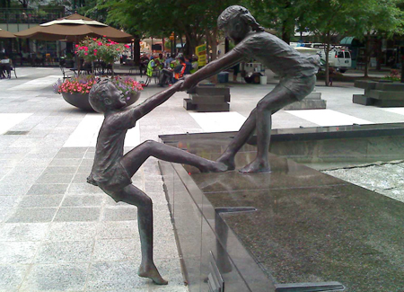 Statues of Children Playing in a Fountain